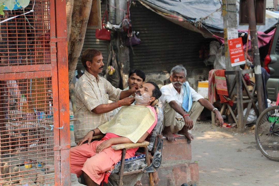 Getting a shave in New Delhi